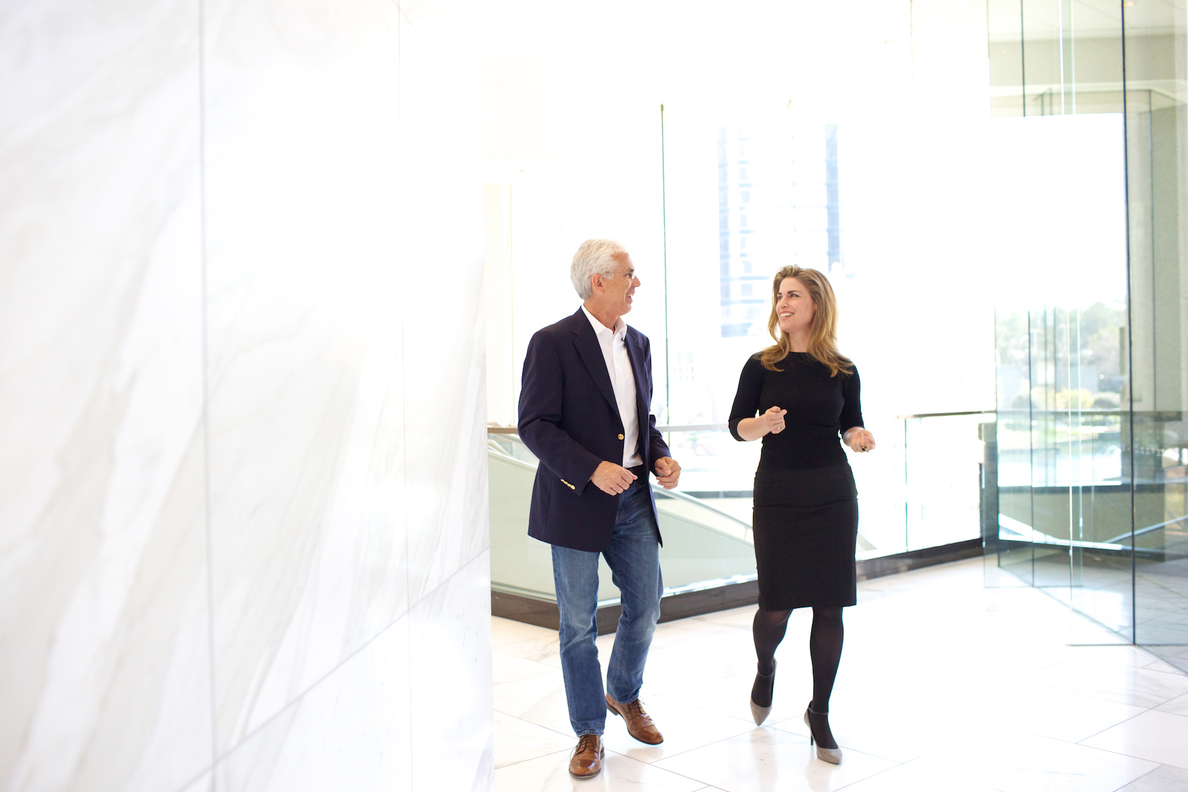 Corporate portrait photography Big Fish Studios man and woman walk and consult in lobby_Robert-Holland