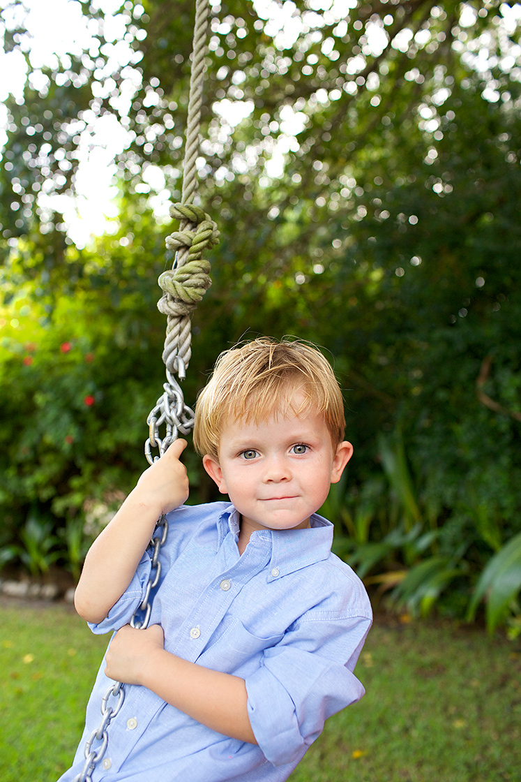 young-boy-portrait-in-front-yard-on-rope-swing-lifestyle-family-and-child-photography-Stuart,-Palm-City,-Hutchinson-Island-Florida-Big-Fish-Studios_Robert-Holland